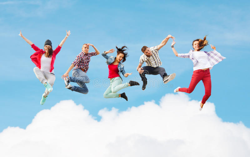 Group of teenagers jumping. Summer, sport, dancing and teenage lifestyle concept - group of teenagers jumping royalty free stock image