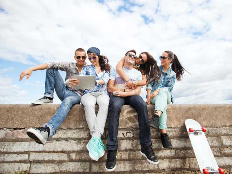 Download Group Of Teenagers Looking At Tablet Pc Stock Photo - Image: 34103682
