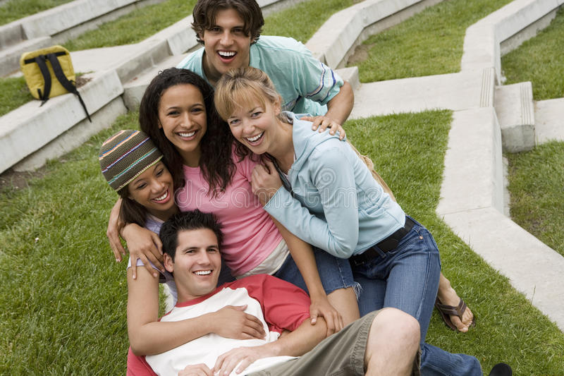 Group of teenagers (17-19) relaxing together, smiling, portrait, elevated view (tilt) royalty free stock images