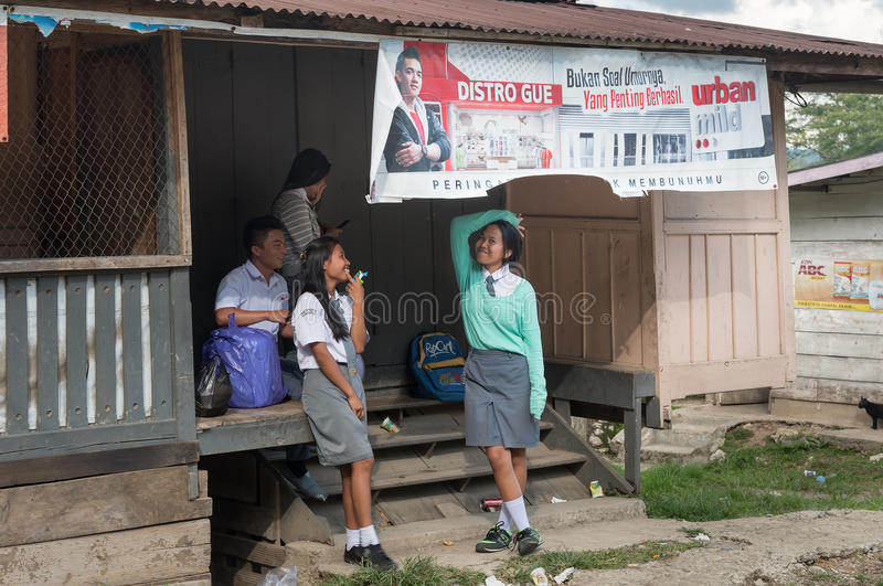 Group of teenagers in school uniform on the doorstep at Tana Toraja stock images