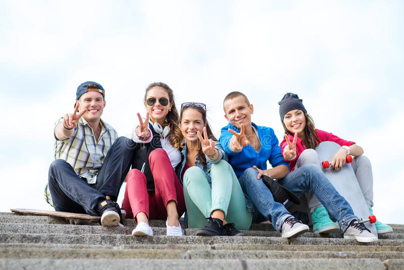Group Of Teenagers Showing Finger Five Stock Images