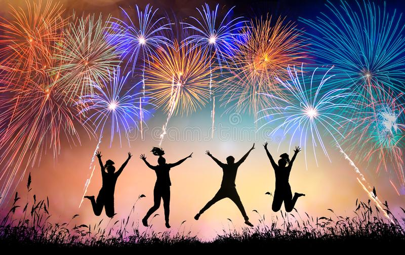 A group of teens jumping with fun and watching the fireworks stock images