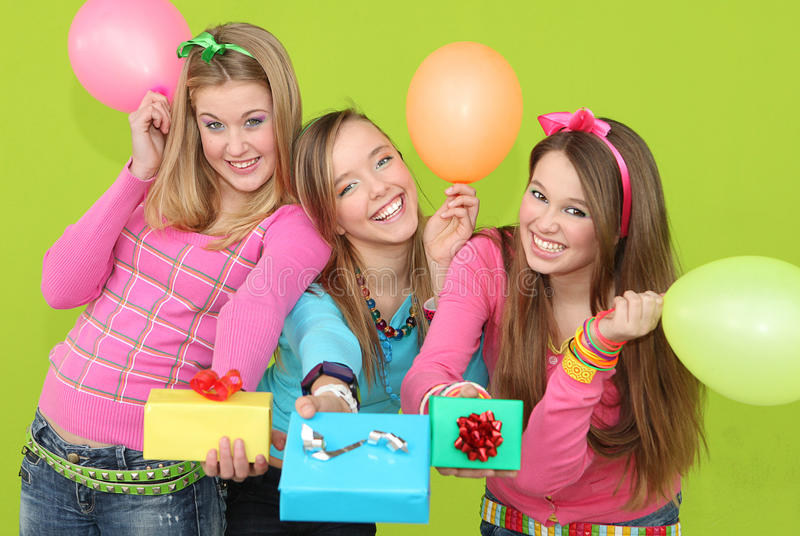 Group Teens party gifts. Group Teens party kids with presents or gifts stock images
