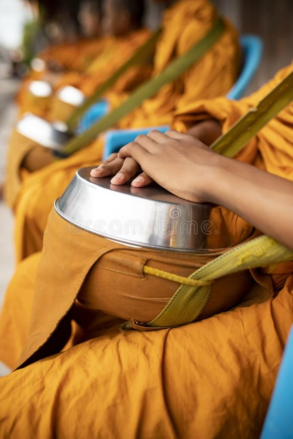 Group of thai monk wearing yellow clothes and holding buddhist bowl waiting for buddhist people offering morning food. Group of thai monk wearing  yellow clothes stock photography