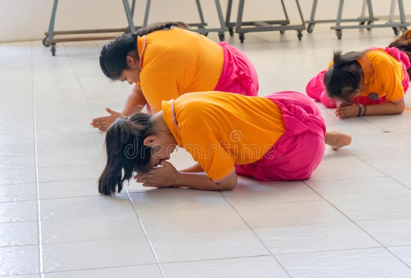 A group of Thai students practicing the old Thai dance in Pattravadhi school Hua Hin, Thailand January 20, 2018 royalty free stock images