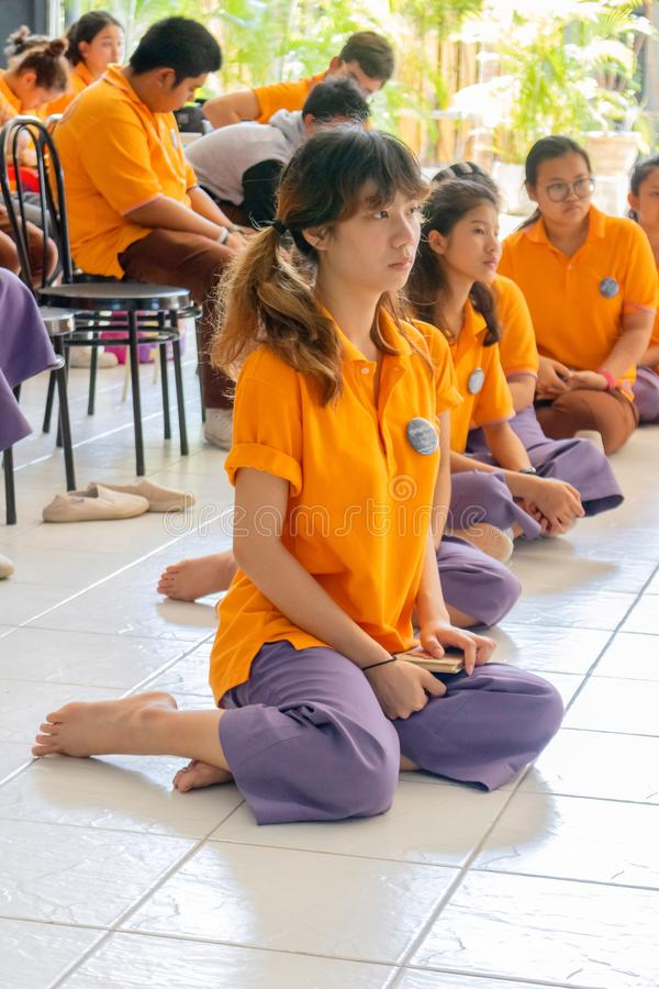 A group of Thai students practicing the old Thai dance in Pattravadhi school Hua Hin, Thailand January 20, 2018 royalty free stock photo