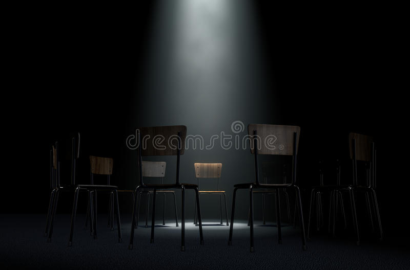 Group Therapy Chairs. A group of chairs in a circular formation with one chair highlighted by a single moody spotlight on a dark background stock images