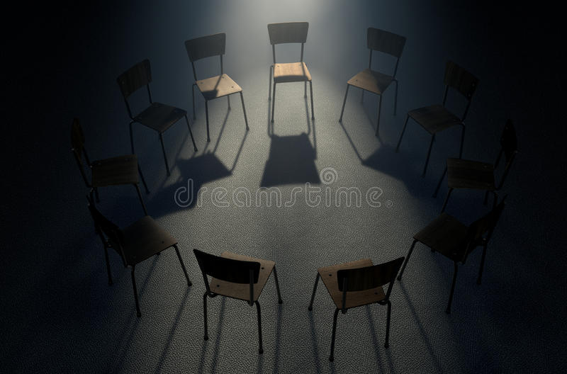 Group Therapy Chairs. A group of chairs in a circular formation with one chair highlighted by a single moody spotlight on a dark background royalty free stock images