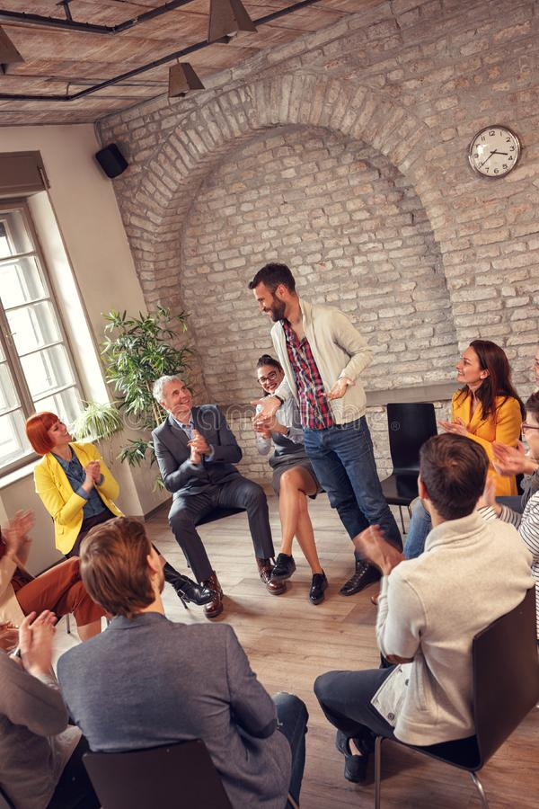 Group therapy meeting- business people discussion. Group therapy meeting- business people diverse discussion stock photo