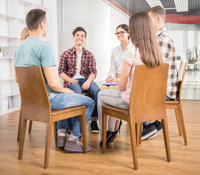 Group therapy. Patients around therapist telling their problems in group therapy session royalty free stock image