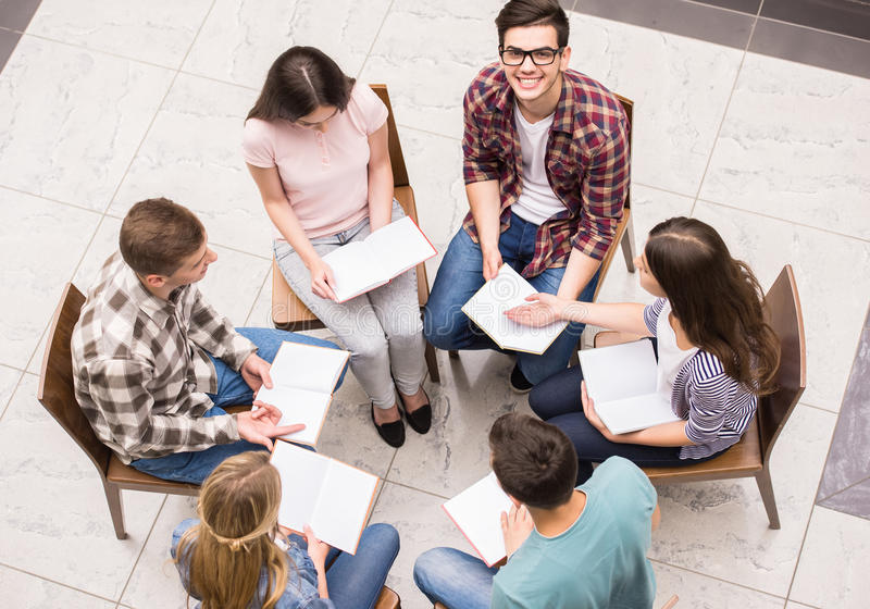 Group therapy. Group of people sitting close to each other and communicating stock photography