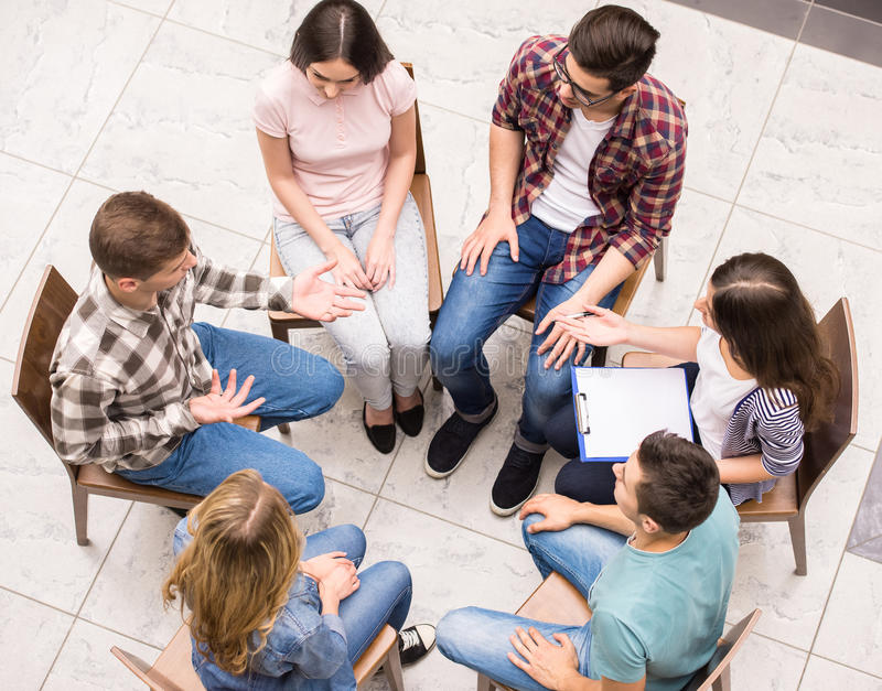 Group therapy. Group of people sitting close to each other and communicating stock image