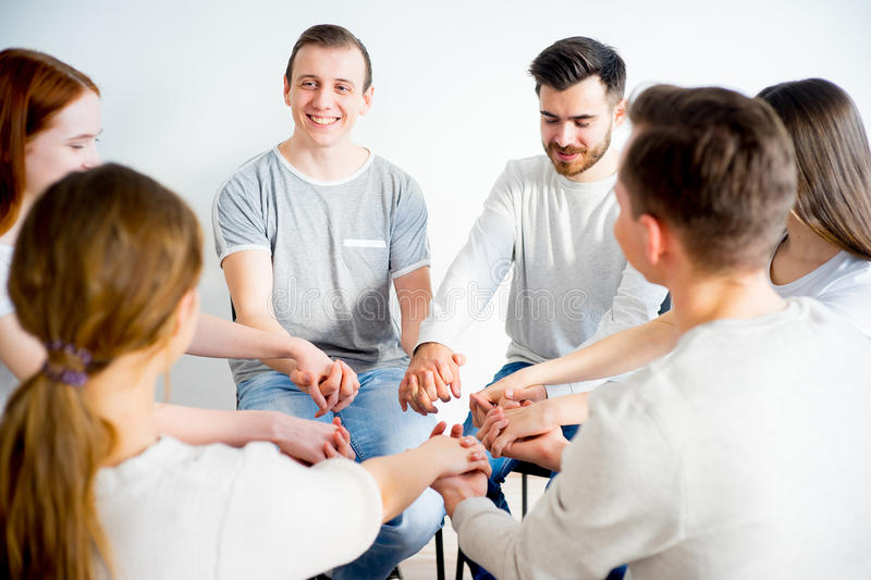 Group therapy in session. People are sitting in circle on a group therapy session royalty free stock photos