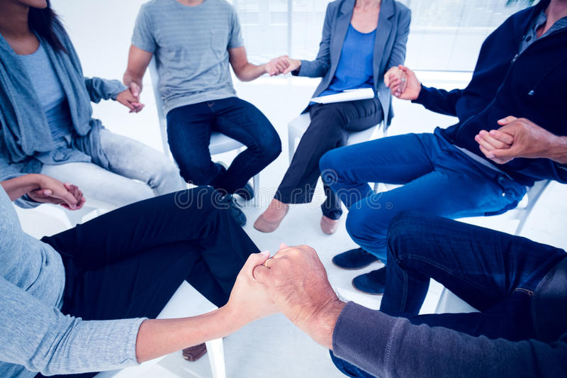 Group therapy in session sitting in a circle. In a bright room royalty free stock photos