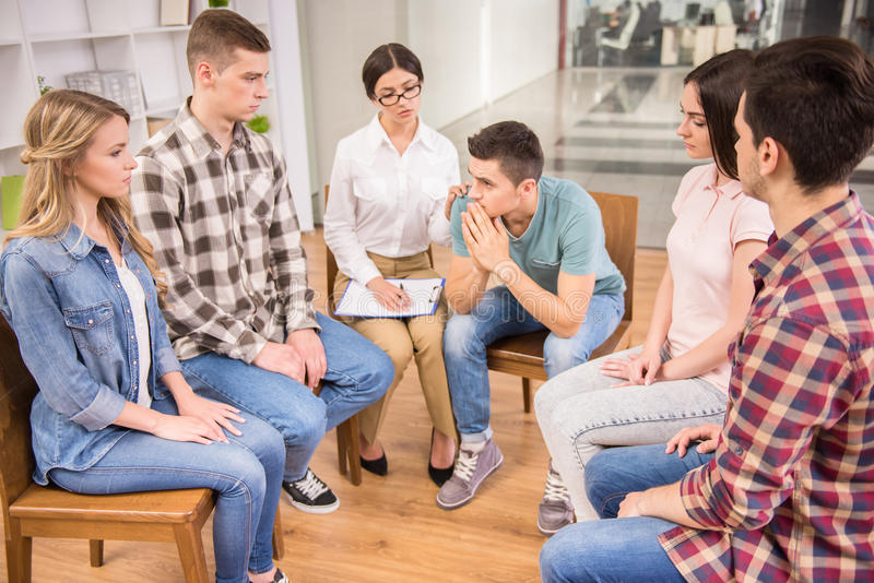 Group therapy. Therapist speaking to a rehab group at therapy session royalty free stock photos