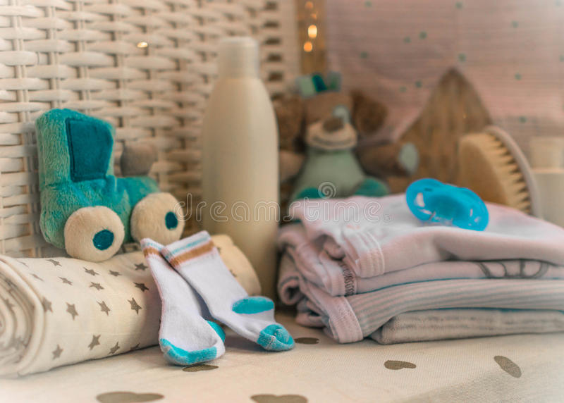 Group of things for baby diapers, cream, nipple, socks composition royalty free stock photo