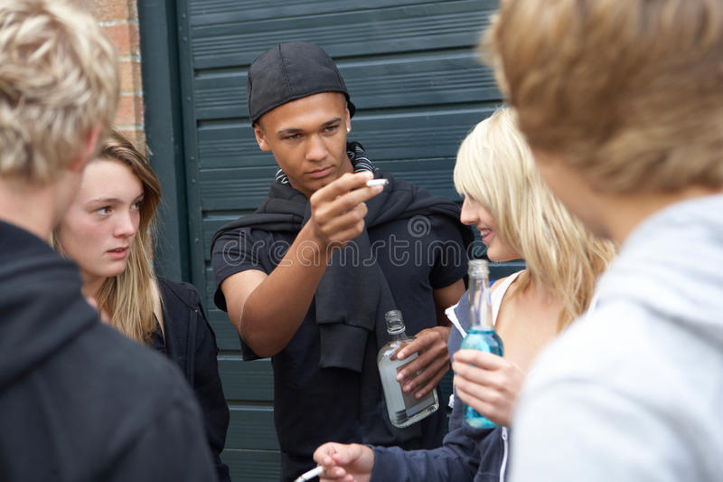 Group Of Threatening Teenagers Hanging Out. Together Outside Drinking royalty free stock photos
