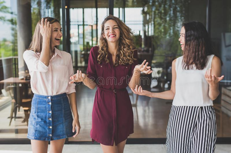 Group of three best friend having conversation while walking tog stock photography