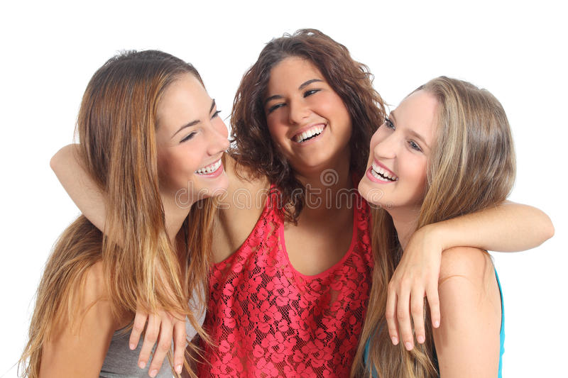 Group of three girls hugging happy. Isolated on a white background royalty free stock photo