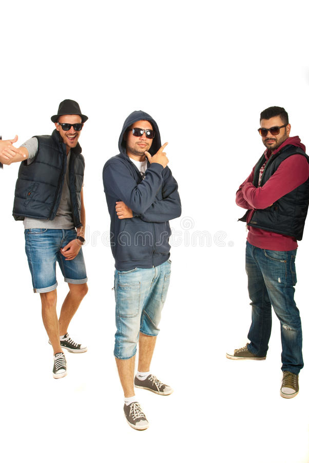 Group of three hip hop dancers. Standing in different dance position isolated on white background stock image