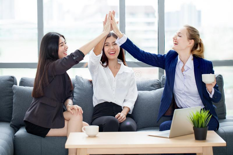 group three young business women teamwork in modern office cele royalty free stock photos