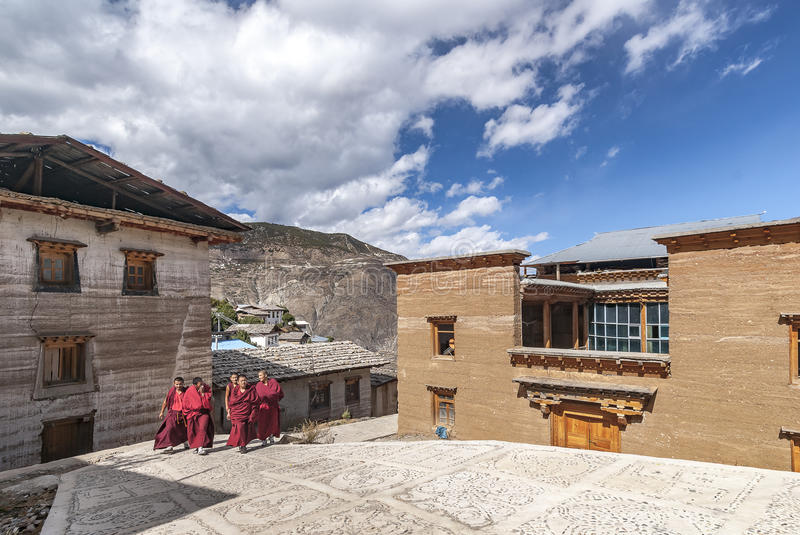 Group of Tibetan monks are walking to perform a funeral ritual stock photography