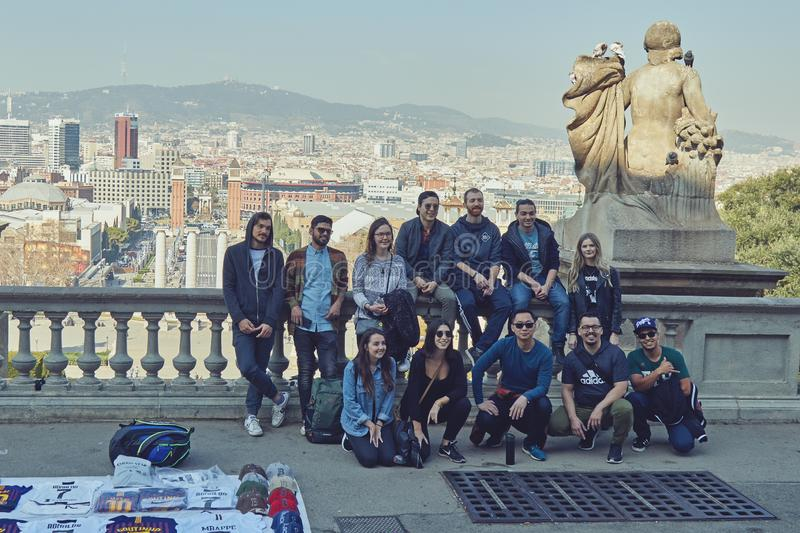 Group of tourist take group picture in Barcelona of Spain. In front of the National Museum of Catalonia. In the background landmark of Barcelona with hill royalty free stock image
