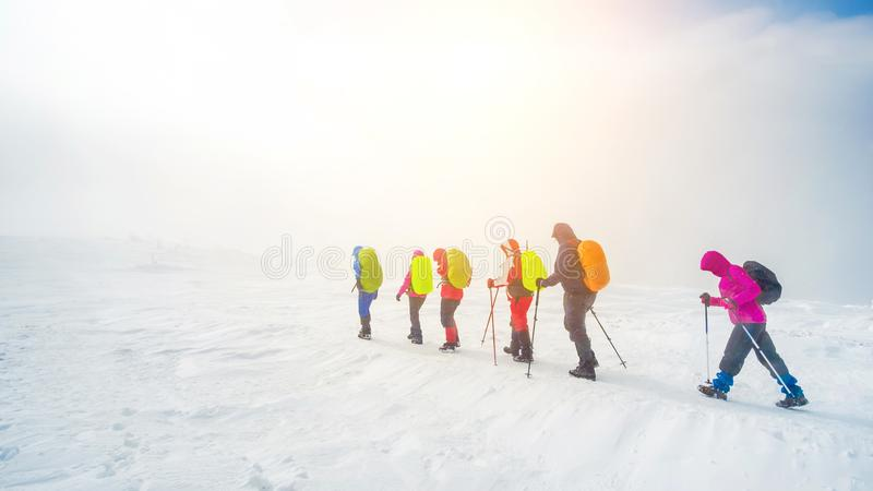 Climbers hike in the mountains stock photography