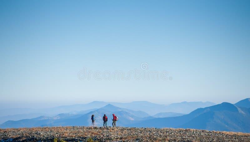 Group tourists enjoying the view on the rocky mountain plato stock image