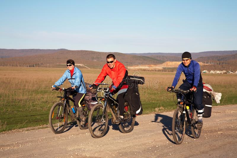 Group of tourists in a hike on bicycles stock photo