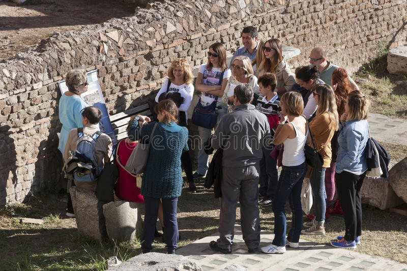 Group tourists with local guide. Ruins in Rome, Italy royalty free stock photos