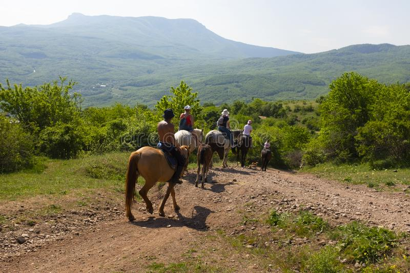 Group of tourists on the mountain equestrian trip on horses around the Ghost valley. Near Alushta, Crimea stock image