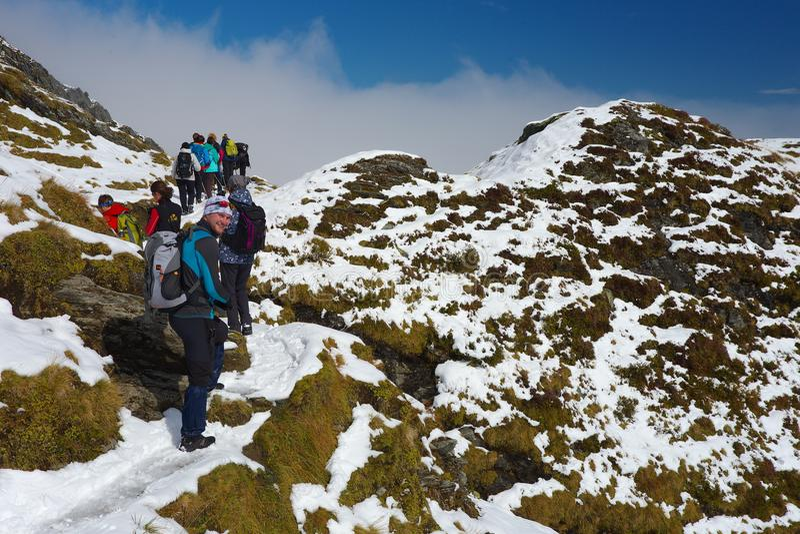 Group of tourists on the mountain ridge nearby ski resort Kaprun royalty free stock image