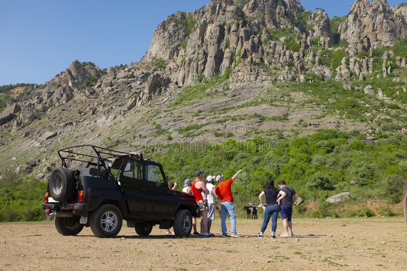 Group of tourists on the off-road truck trip at the foot of the mountain Demergy near Alushta, Crimea stock image