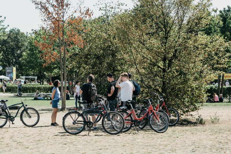 A group of tourists riding bikes sightseeing in Berlin in Germany. Excursion on the bike. royalty free stock photography