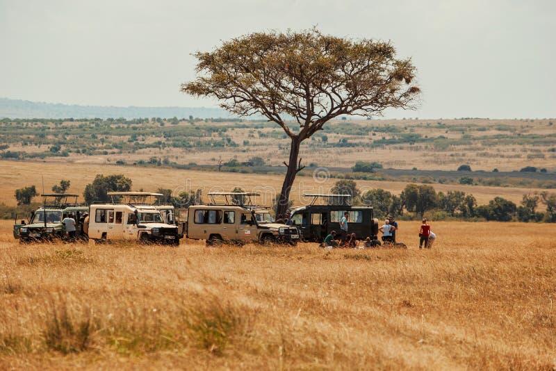 A group of tourists in Savannah Grassland in Masai Mara, Kenya stock image