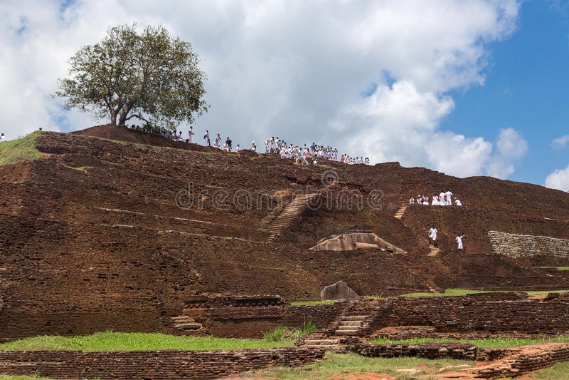 Group of tourists visiting Sigiriya complex royalty free stock photo
