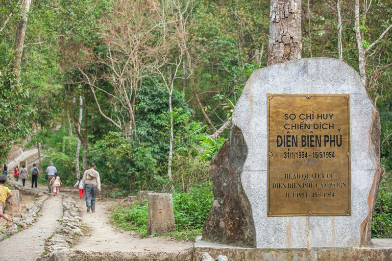 A group of tourists walking on a trail at Headquarters of Dien Bien Phu Campaign in primeval forest. Dien Bien District, Vietnam. A group of tourists walking on stock images