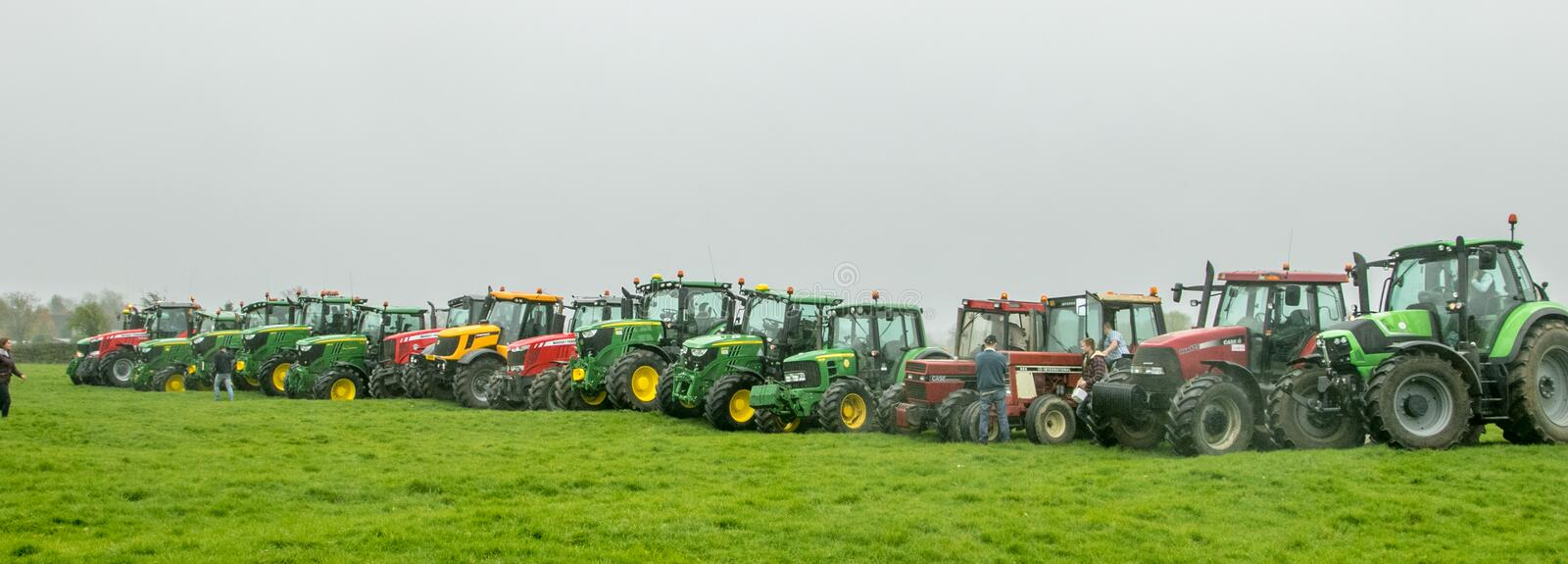 A group of tractors parked up. A group of john deere tractors parked up in a line row all different makes and colours in show royalty free stock images