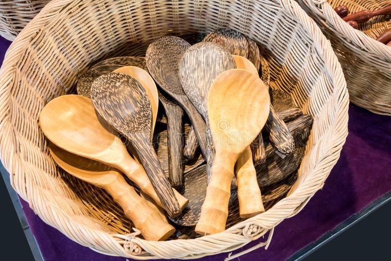 A group of traditional wooden spoons in basket. stock images