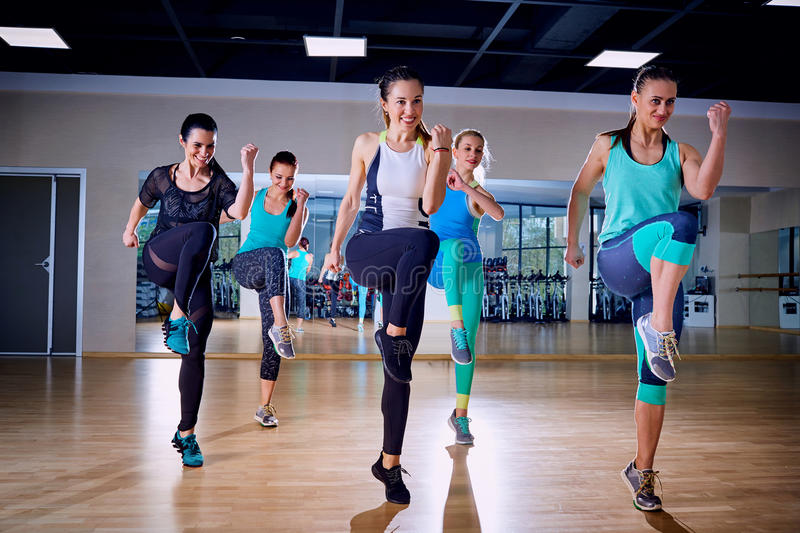 Group training of girls in the gym royalty free stock images
