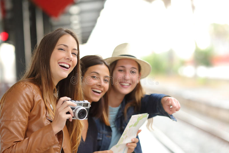 Group of traveler girls traveling in a train station royalty free stock photography