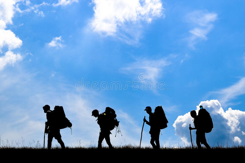 Group of travellers with backpacks on top of mountain.  royalty free stock photo