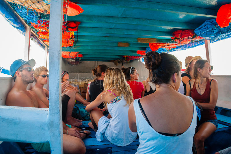 Group of travellers on public indonesian boat royalty free stock image