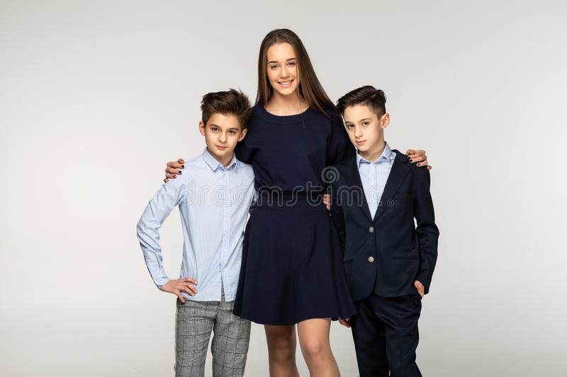 Group of two cute brothers and beautiful sister stock photo