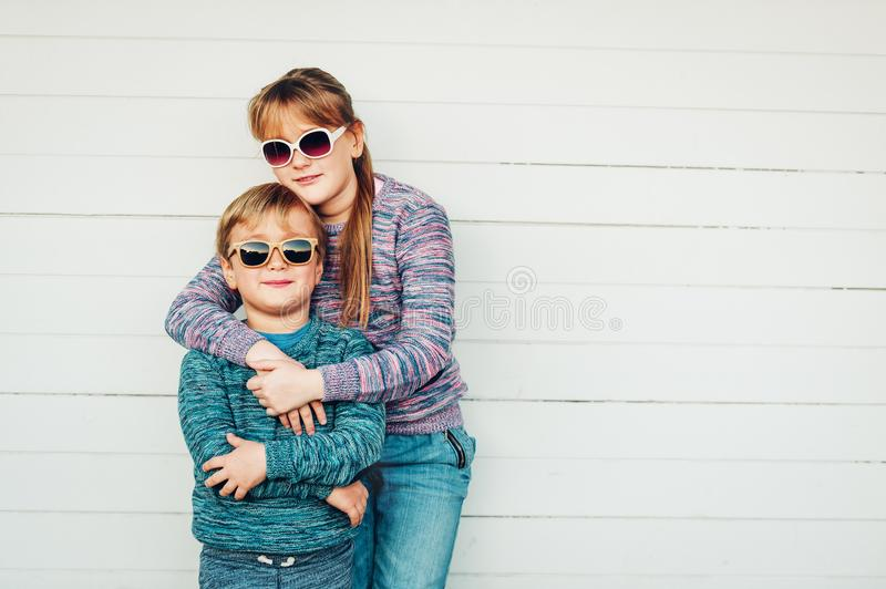 Group of two funny kids playing together outside royalty free stock image
