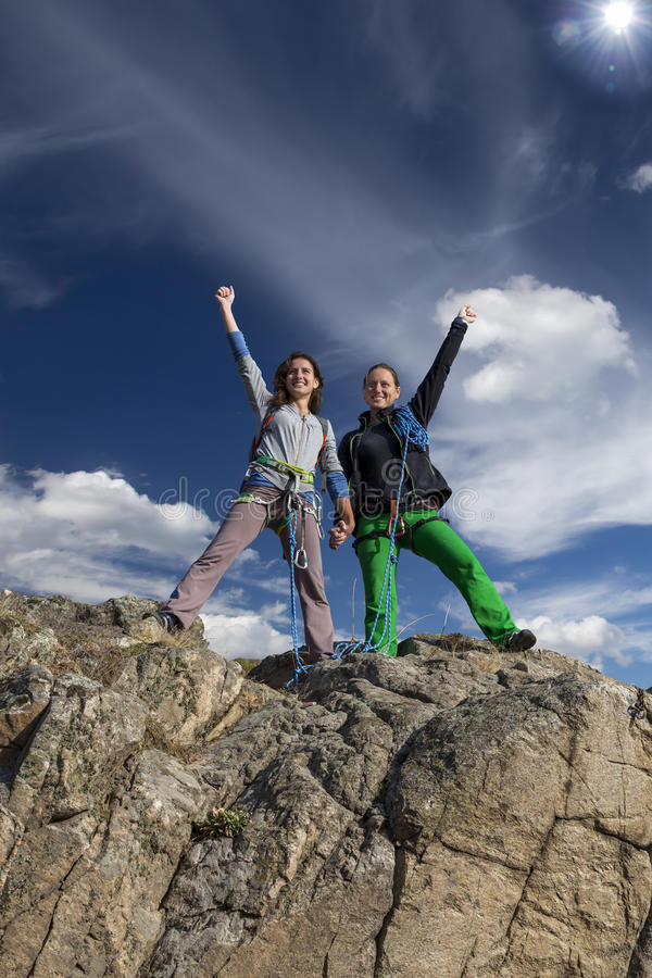 Group of two happy female climbers royalty free stock image