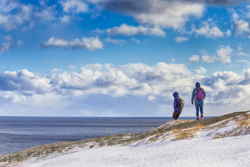 Group of Two People Traveling on Mountains of Lofoten Islands in Norway royalty free stock images