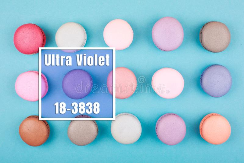 Group of Ultra Violet macarons. Group of Ultra Violet colorful macarons on trendy background. Color of the year 2018. Frame with code and name of the color stock photo