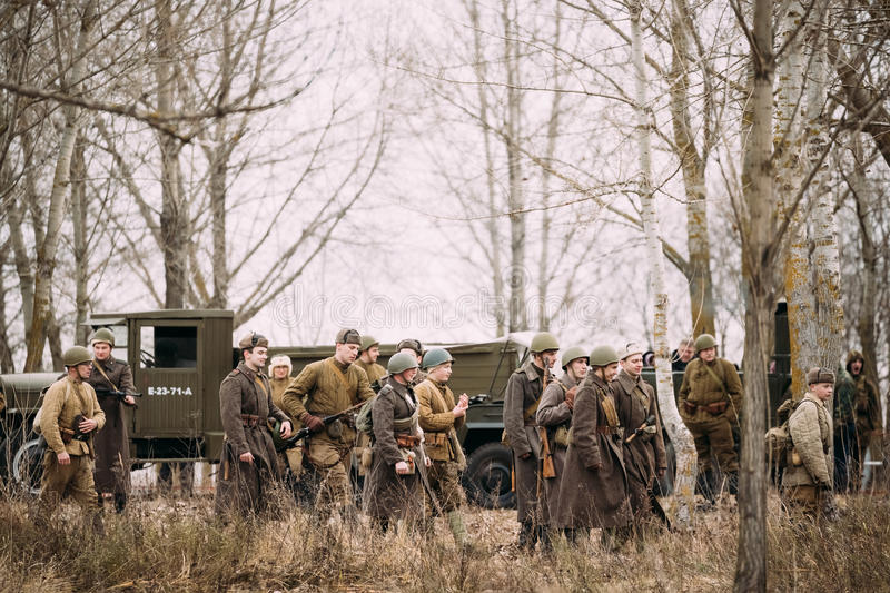 Group Of Unidentified Re-enactors Dressed As Russian Soviet Infantry Soldiers. Gomel, Belarus - November 26, 2016: Unidentified Re-enactors Dressed As Russian stock photography
